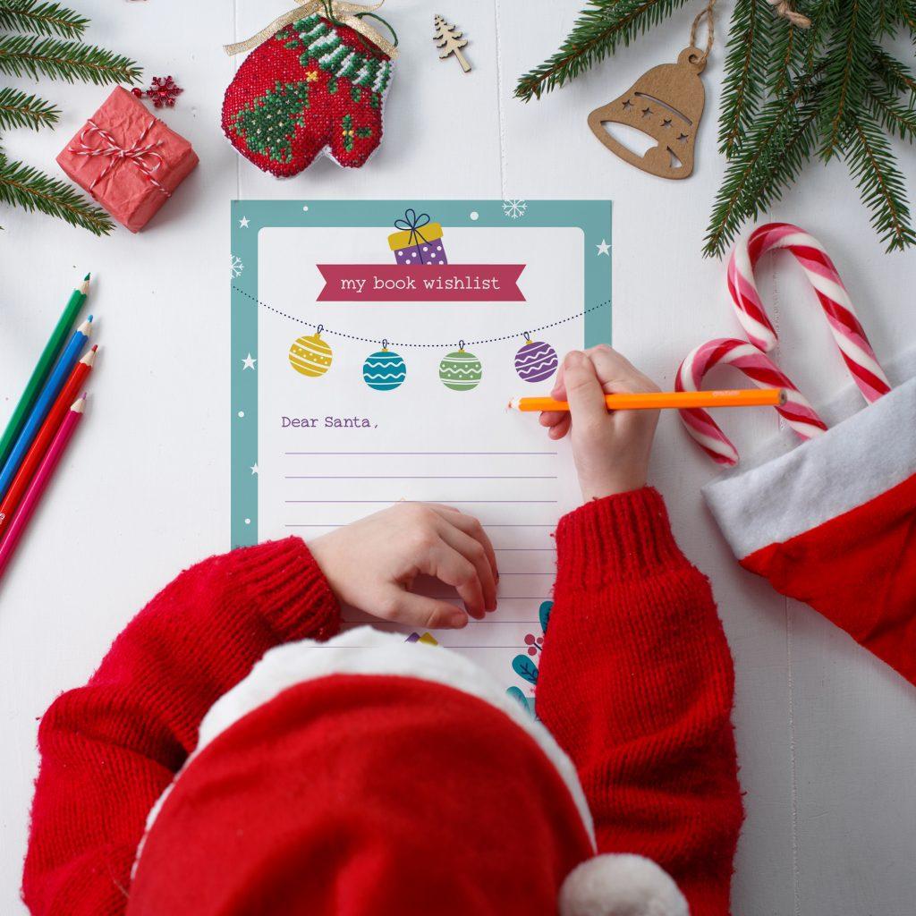 bambino che scrive la lettera per Babbo Natale con grafica 1to1books